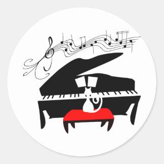 Katt & piano runt klistermärke
