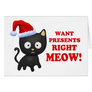 Katten önskar julklappar som höger jamar hälsningskort