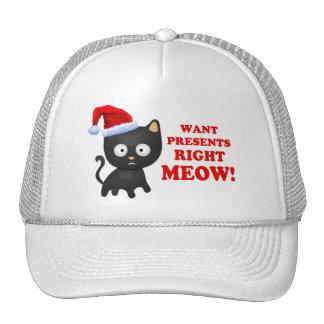Katten önskar julklappar som höger jamar keps