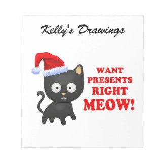 Katten önskar julklappar som höger jamar memo pad