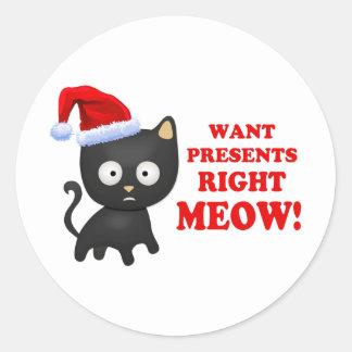 Katten önskar julklappar som höger jamar runt klistermärke