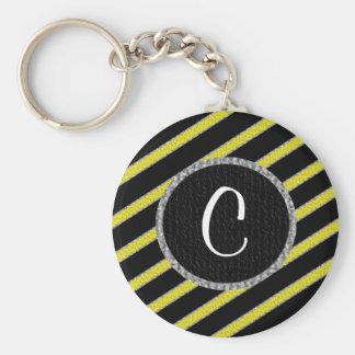 Keychain för gult- och svartrandmonogram rund nyckelring