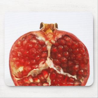 Klippte halvan en mogen pomegranate till blottan musmatta