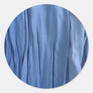 Klistermärke för blåtttygrunda