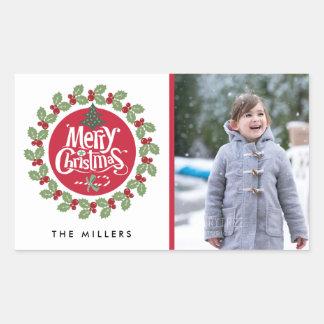 Klistermärke för helgdag för god julkranfoto