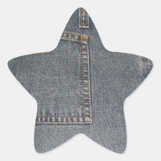 Klistermärke för stjärna för Denium tygbakgrund