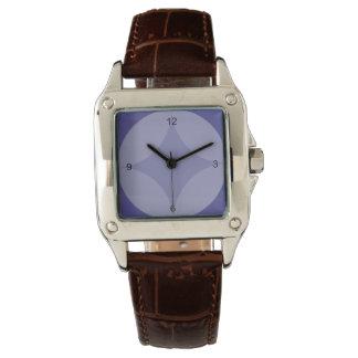 Klockan - cirkla och diamanten på blått armbandsur