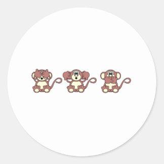 kloka apor runt klistermärke