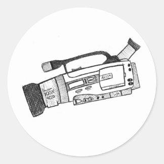 Klottra videokameraklistermärken runt klistermärke