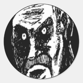 Komiskt ansikte för ilsken stirrande runt klistermärke