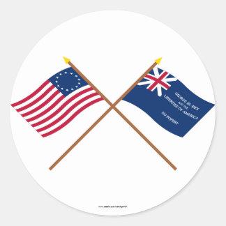 Korsad Betsy Ross och George Rex flaggor Runt Klistermärke