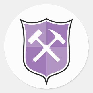 Korsad sten bultar skyddar runt klistermärke
