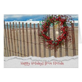 Kran för julbärstrand på staket hälsningskort