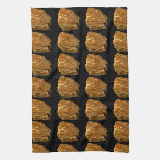 Krönat Baritefoto som beläggas med tegel på Kökshandduk