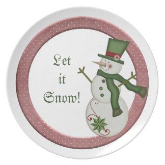 Krw-landsnögubben låt det snöa för att plätera dinner plate