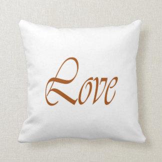 Kudde av kärlekguld på vit