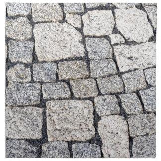 Kullersten av en gata specificerar in tygservett