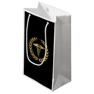 Kungligt guld- Caduceussymbol för medicinsk