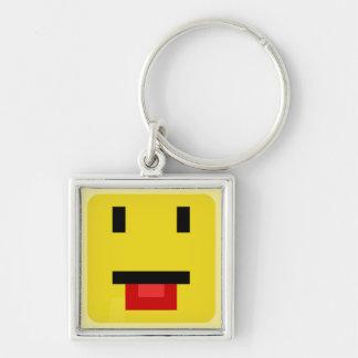 kvadrerad smiley som petar tungan fyrkantig silverfärgad nyckelring
