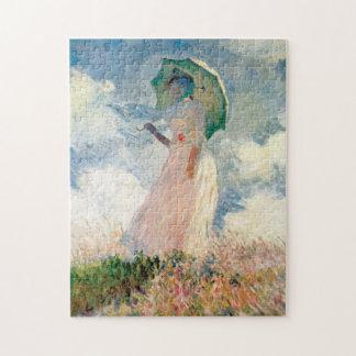 Kvinna med ett slags solskyddpromenaden Monet Pussel