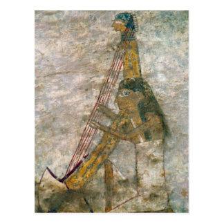 Kvinna som leker en välvd harpa vykort