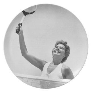 Kvinna som leker tennis 2 tallrik