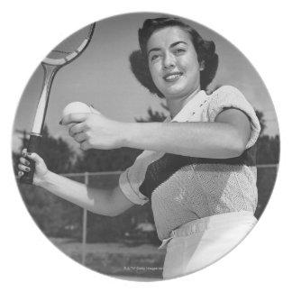 Kvinna som leker tennis 3 tallrik