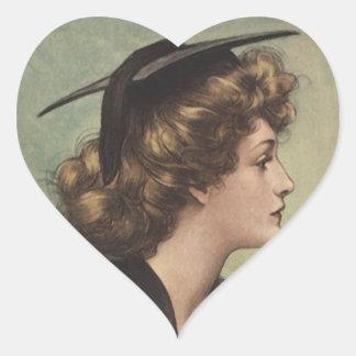Kvinnan för kappan för hjärtformat klistermärke