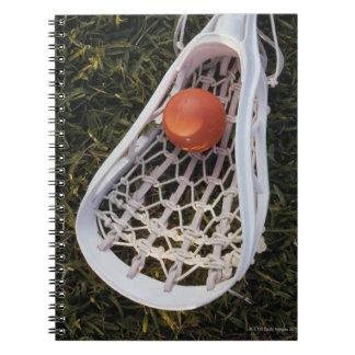 Lacrossepinne och boll anteckningsbok med spiral
