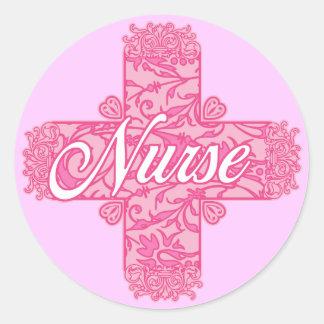 Lacy rosasjuksköterskakor runt klistermärke