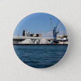Ladda last av rå material från förtöja för port standard knapp rund 5.7 cm