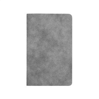 Läderlooken kritiserar in grått anteckningsbok
