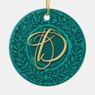 Lagrarkran med den guld- monogramen i turkos rund julgransprydnad i keramik