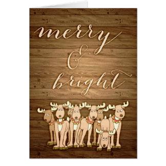 Lantligt wood ljust julhälsningkort som är glatt & hälsningskort