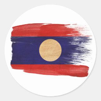 Laos flagga runt klistermärke