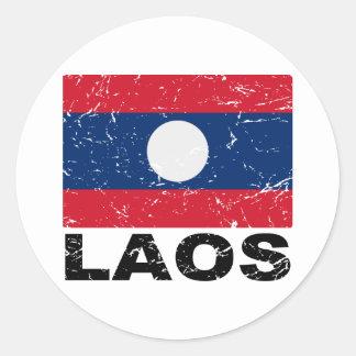 Laos vintageflagga runt klistermärke