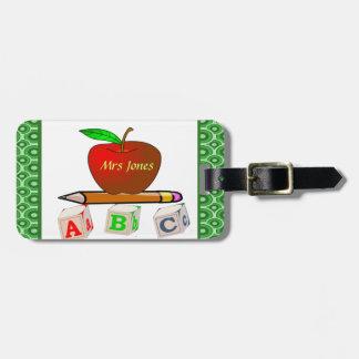 Lärare ABC personifierar Bagagebricka