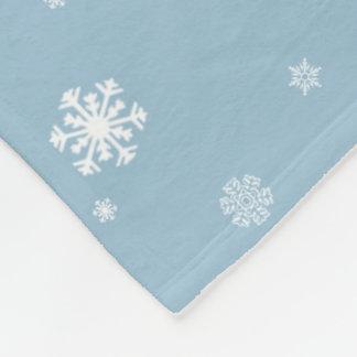 Låt det snöa snöflingormönster på blått, vinter fleecefilt