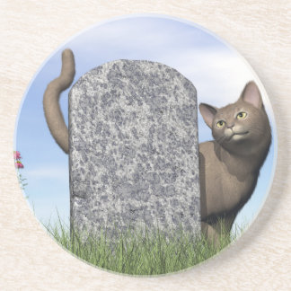 Ledsen katt nära gravstenen underlägg sandsten