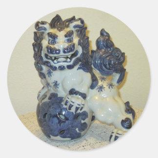 Lejona (leoparden) klistermärkear för snö runt klistermärke