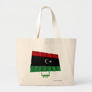 Libyen som vinkar flagga med namn i arabiska kassar