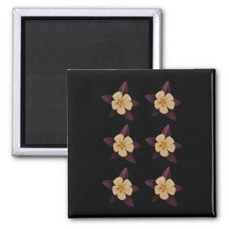 Lila- och vitblommor magnet