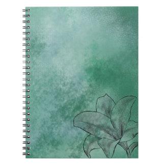 Lilja i blått anteckningsbok med spiral