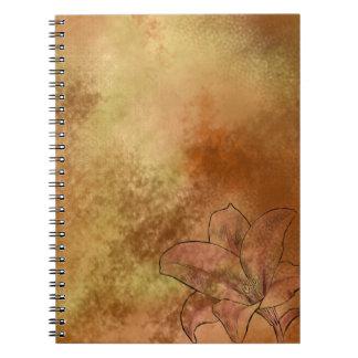 Lilja i orange anteckningsbok med spiral