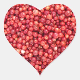 Lingonbakgrund Hjärtformat Klistermärke
