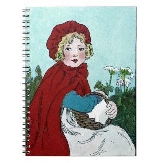 Lite röd ridninghuvaanteckningsbok anteckningsbok med spiral
