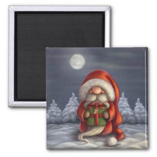 Lite Santa med en gåva