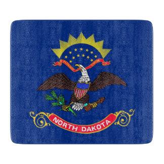 Liten glass skärbräda med den North Dakota flagga