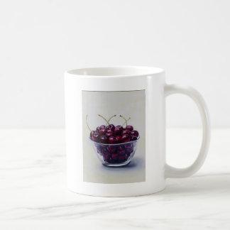 Liv är en bunke av körsbär kaffemugg