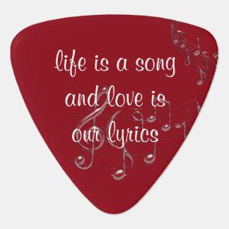 Liv är gitarrer Plektrum för en sång